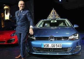 Volkswagen design chief Walter de Silva holds the trophy