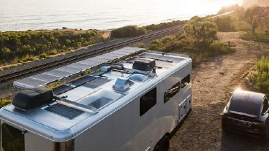 Photo of Living Vehicle and Volta Power Systems partner on luxury trailer